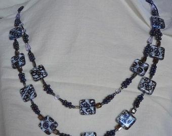 Light blue Czech glass with swirls necklace