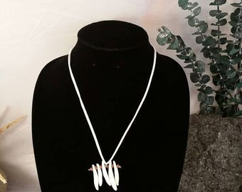 """Necklace with real coyote teeth. Measures 20"""" around."""