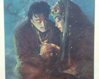 A 1950's mounted Indian magazine print of two lovers in moonlight.