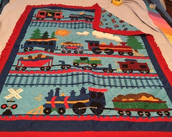 Baby or toddler boy quilt.  Trains 37x45