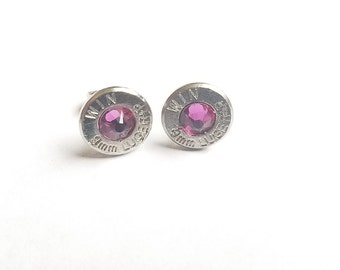 Bullet jewelry.  9mm stud earrings with Swarovski crystals.  Silver in color with a stunning pink crystal bead