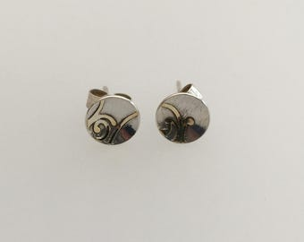 Sterling silver and gold swirl earrings