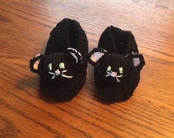 Black kitty slippers.
