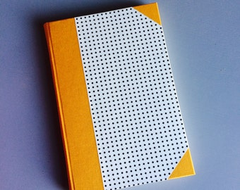 Hand bound A5 notebook journal quarter bound with orange book cloth and fine paper bookbinding
