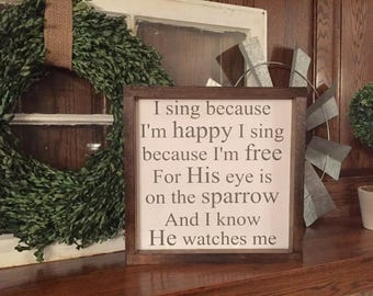 I sing because I'm happy wooden framed sign
