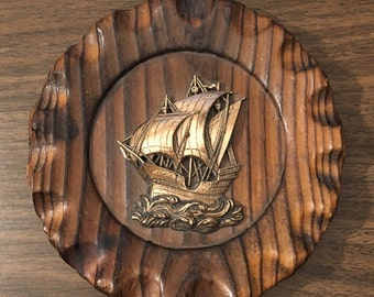 Vintage Wooden Plaque With Ship Sailing Over The Waves.