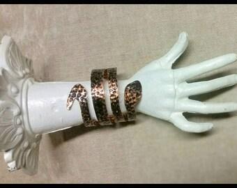 Copper snake cuff bracelet.