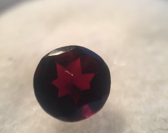 Round faceted garnet gemstone