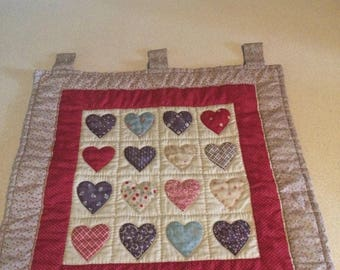 Quilted heart wall hanging.