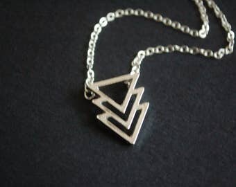 Silver tone tribal arrow necklace