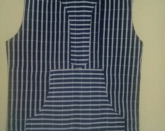 sleeveless smock shirt. Available in small, medium, and large.