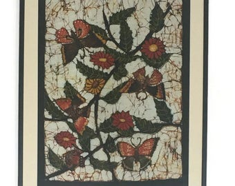 Handmade batik in a frame.