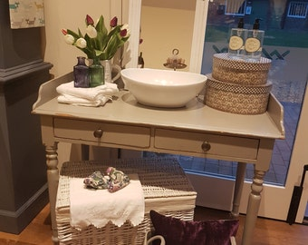 Mid grey washstand with ceramic basin with chrome waste and plug
