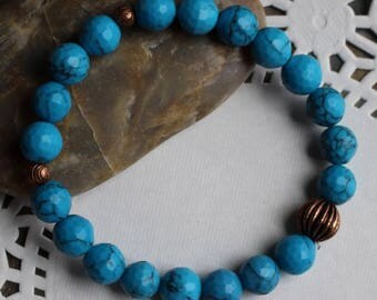 Blue howlite bracelet with copper melon beads, clear elastic cord, B028