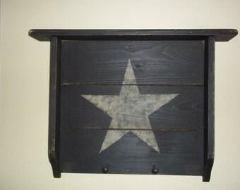 Primitive black shelf woth beige star