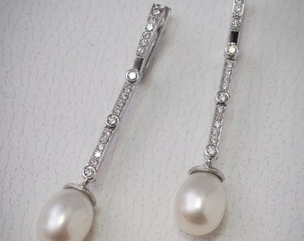 Hand made earrings, white gold with diamonds and pearls