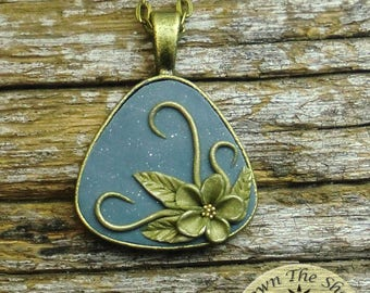 Vintage style bronze and blue floral triangle pendant