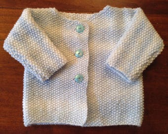 Blue and white vest for 6 month old baby, entirely knitted hand.