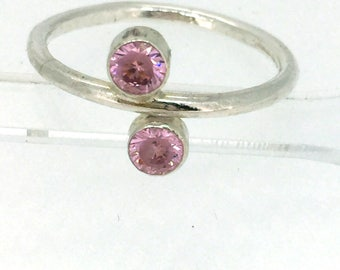 Silver ring with two pink faceted stones