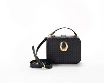 braided black leather bag