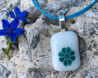 Teal flower fused on white
