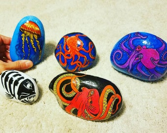 Hand painted otopus, jellyfish, and skeleton fish rocks each sold separately