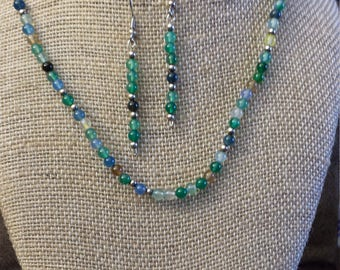 Various shades of blue and green beaded necklace with earrings