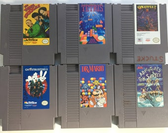 Original NES Games: The Three Stooges, Tetris, Gauntlet II, Ghostbusters II, Dr Mario, Adventures of Tom Sawyer, Skate or Die, Narc, Yoshi
