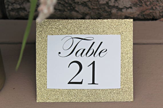 Like this item? & Calligraphy and Gold Glitter Tent Style Table Numbers sets