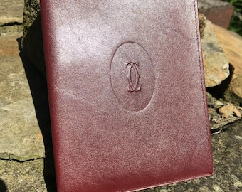 Vintage Cartier ticket and bank note holder. Classic Cartier maroon leather wallet