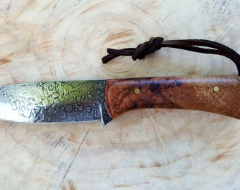 High carbon steel with stabilized red oak burl handle.