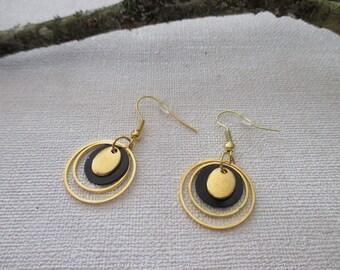 Rings and sequin earrings