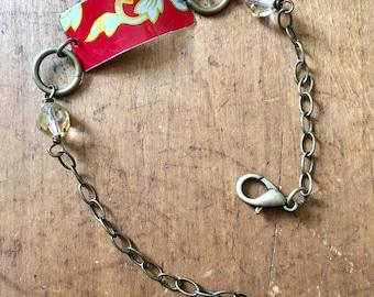 Red and white vintage tin bracelet