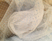 Flocked Polka Dot Tulle 59 inch wide white tulle with small light white swiss polka dots Ivory black baby blue
