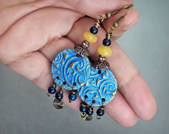 Bohemian Style Artisan Earrings. Lovely blue shades polymer clay beads. Brass and copper findings.