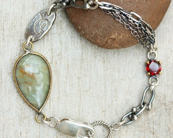 Jasper teardrop bracelet in brass bezel setting with round faceted garnet secondary gemstone and oxidized sterling silver chain