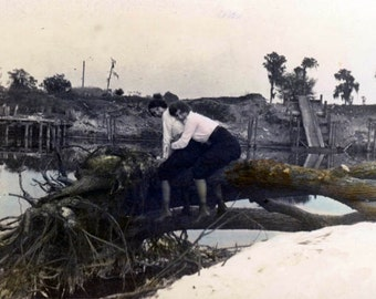 vintage photo Affectionate Women Hug From Back Fallen Tree River Beach Hand Colored Lesbian in