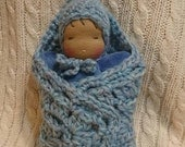 Waldorf-inspired doll-baby in a granny pouch