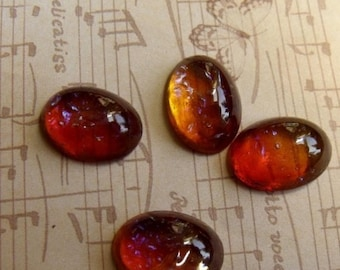 On Sale 25% Off Rare Mexican Opal or Dragons Breath Glass Cabochons 18X13mm Oval 4 Pcs