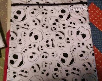Lined NIGHTMARE BEFORE CHRISTMAS zippered pouch. 10x12 inch. New and ready for your goodies.