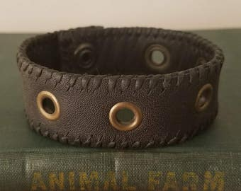 "Handmade 8.5"" charcoal gray, grommeted leather, stitched bracelet."