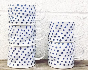 Blue polka porcelain crumple cup with translucent bottom