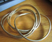 twist interlock bangle