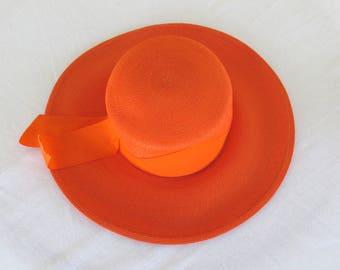 1970's vintage bright orange straw wide brim hat with grosgrain ribbon