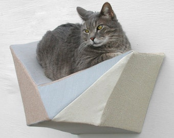 Cat shelf wall bed in grey, tan, beige and ivory