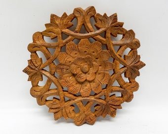 Hand carved wood trivet from India