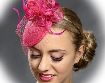 Small hot pink fascinator headpiece with veil and feathers