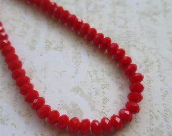Small red faceted glass beads