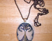 "Art Deco Swans  With Glitter Pendant Necklace  24"" Chain"