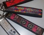 Black key fob wristlet, key fob, key chain,  key fob wristlet, lacrosse, autism awareness, gucci, coach, gifts
